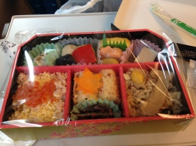 Assorted mochi rice, ikura salmon eggs, vegetables