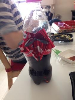 Coke label turns into ribbon
