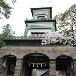 Gate of Oyama Shrine, half pagoda, half European building.