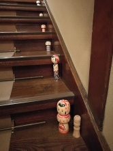 Dolls, all the way up the staircase